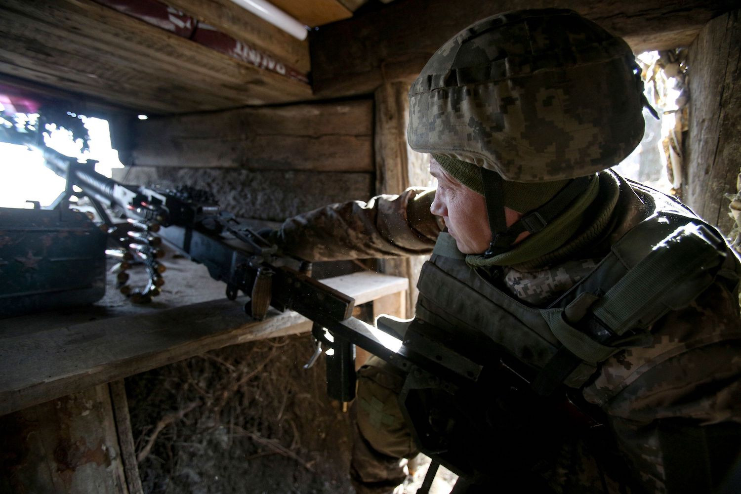 Ukrainian serviceman stands in position on the front line with separatists in Donetsk region on February 19, 2021.